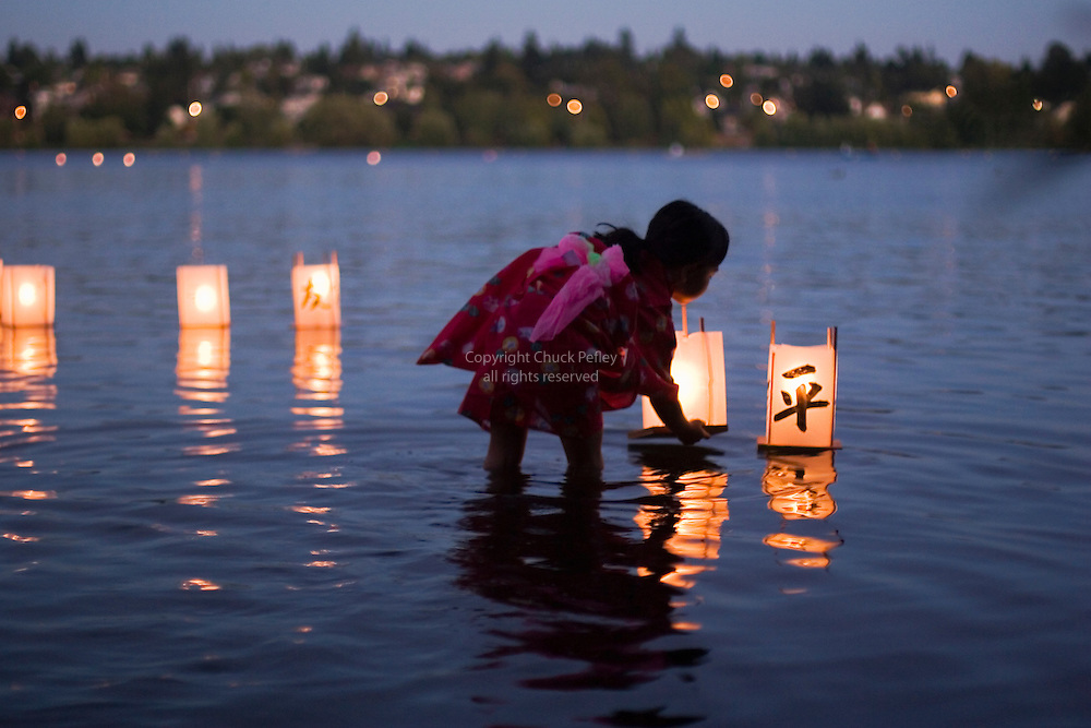 Toro Nagashi lantern floating ceremony on Green Lake in Seattle, Washington commemorating the 60th remembrance of the victims of the atomic bombings of Hiroshima and Nagasaki Japan and all victims of war and violence