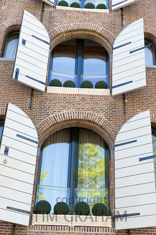 Old style traditional shutters on modern building in Amsterdam, Holland, The Netherlands