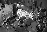 """Laurence Harvey films a plane crash scene on the set of """"The Running Man"""" at Ardmore Studios, Co. Wicklow..27.09.1962"""