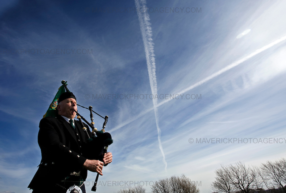 Lyle Crawford from North Berwick Pipe band plays the pipes in front of a St Andrews cross in the sky in Athelstaneford.  Bands from the Royal Scots Association of Pipe Bands perform at the final Tartan Week parade in East Lothian to celebrate the Homecoming Scotland initiative.