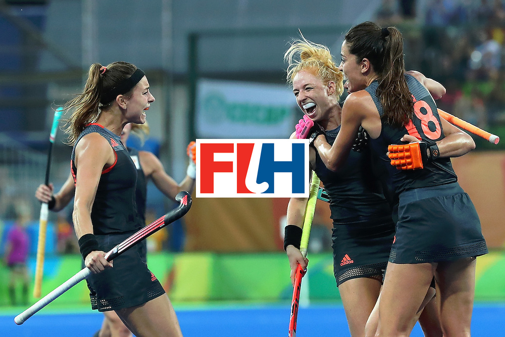 RIO DE JANEIRO, BRAZIL - AUGUST 19:  Netherlands players celebrate the their sides second goal scored by Maartje Paumen (hidden) during the Women's Gold Medal Match against the Netherlands on Day 14 of the Rio 2016 Olympic Games at the Olympic Hockey Centre on August 19, 2016 in Rio de Janeiro, Brazil.  (Photo by Tom Pennington/Getty Images)