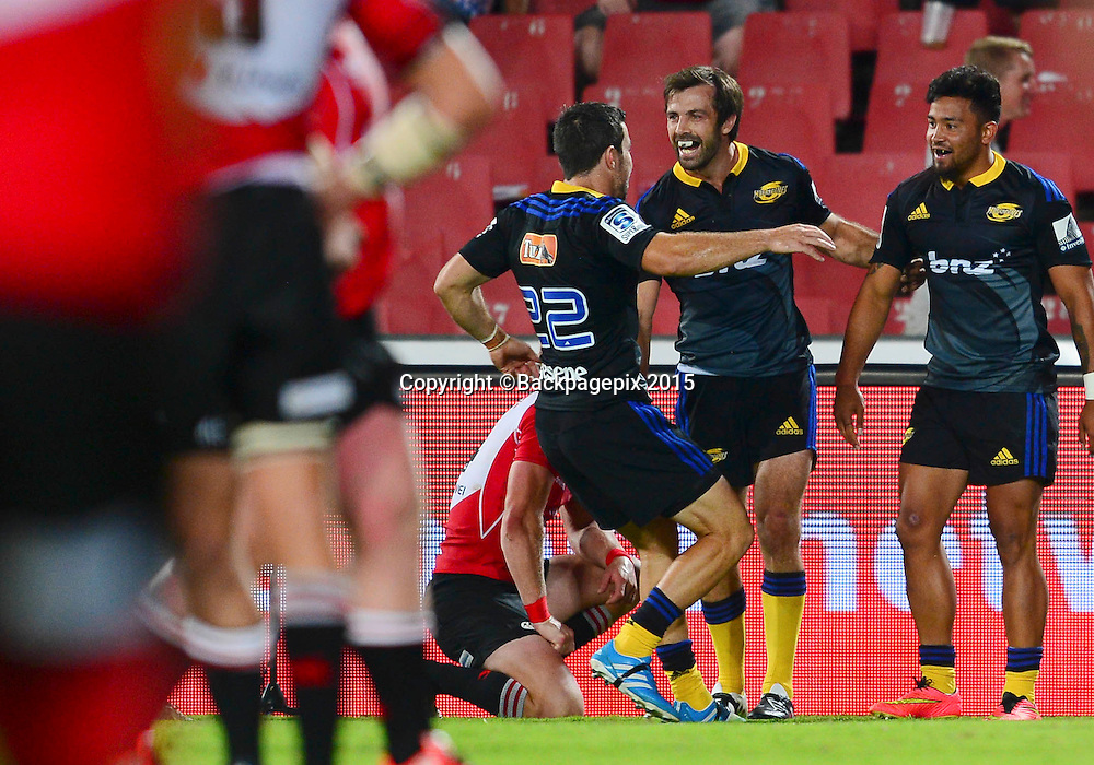 Conrad Smith of the Hurricanes congratulates Matt Proctor of the Hurricanes during the 2015 Super Rugby rugby match between the Lions and the Hurricanes at Ellis Park in Johannesburg, South Africa on February 13, 2015 ©Barry Aldworth/BackpagePix
