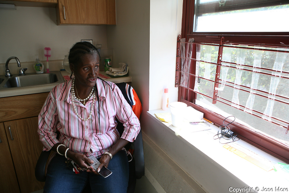 Annie Ricks and her family were the last residents to move out from the Cabrini Green low income high rise building. They moved to Wentworth Gardens, a public housing project that Ricks claims is not safe for her family. Ricks said she spent much of her time sitting at the kitchen window of her second-floor apartment, watching the courtyard. She keeps her shoes nearby in case she has to hurry out to protect her children.<br /> Photography by Jose More
