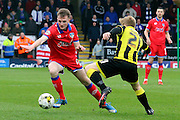 Oldham midfielder Carl Winchester wins the ball during the Sky Bet League 1 match between Burton Albion and Oldham Athletic at the Pirelli Stadium, Burton upon Trent, England on 26 March 2016. Photo by Aaron Lupton.
