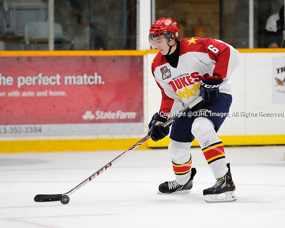 TRENTON, ON - Oct 3, 2014 : Ontario Junior Hockey League game action between Wellington and Trenton, Jacob Hetherington #6 of the Wellington Dukes skates with the puck during the third period<br /> (Photo by Amy Deroche/ OJHL Images)