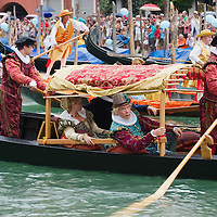 VENICE, ITALY - SEPTEMBER 04:  Rowers wearing traditional costumes sail on the Grand Canal during the Historic Regata on September 4, 2011 in Venice, Italy. The Historic Regata is the most popular boat race on the Gran Canal for locals and tourists alike.