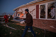 Nov. 17, 2013 - Washington, IL, USA - <br /> <br /> Deadly Tornadoes Hit Illinois<br /> Dan Elbert, center, helps his friends on Devonshire Road after a tornado left a trail of damage along in Washington, Ill., on Sunday, Nov. 17, 2013.<br /> ©Exclusivepix