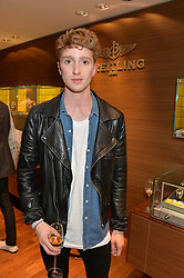 LUKE NEWBERRY at a party to celebrate the 30th Anniversary of the Breitling Chronomat held at 130 Breitling, New Bond Street, London on 7th May 2014.