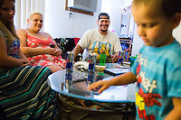Jason Hill spends time with his son Jordan Hill, 4, his fiancè Iris Leland and her sister Lilly LeMoine before going to work Friday, July 24, 2015 in Spokane, Wash.