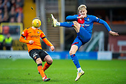 Coll Donaldson (#5) of Inverness Caledonian Thistle FC clears the ball ahead of Nicky Clark (#10) of Dundee United FC during the William Hill Scottish Cup quarter final match between Dundee United and Inverness CT at Tannadice Park, Dundee, Scotland on 3 March 2019.