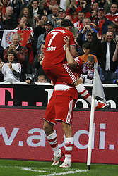 Franck Ribery jumps on top of Luca Toni after he scores during the Bundesliga match between Bayern Munich and Bayer Leverkusen, 12th May 2009.<br /> <br /> UK ONLY