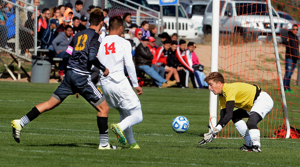 jt110316c/ sports/jim thompson/ Pius' keeper #3 Seth Matteucci scoop sup the ball  in their game during the state boys soccer tournament. Thursday Nov. 03, 2016. (Jim Thompson/Albuquerque Journal)