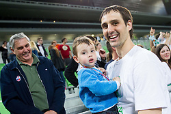 Domen Lorbek of Krka celebrates with his son and father after winning the basketball match between KK Krka and KK Union Olimpija in 4th Final match of Telemach League 2012/13 on May 20, 2013 in Arena Stozice, Ljubljana, Slovenia. Krka defeated Union Olimpija third times and become Slovenian Champions 2013. (Photo By Vid Ponikvar / Sportida)