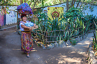 Lake Atitlan, Guatemala.  There are no cars or roads in San Marcos La Laguna so small pathways thru the village are meeting places for indigenous folks carrying vegetables and wearing traditional clothing