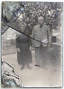 broken and eroding glass plate of senior couple