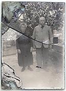 broken and eroding glass plate of senior couple