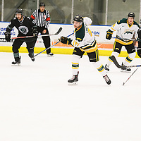 5th year forward Stephen Langford (21) of the Regina Cougars in action during the Men's Hockey Shine On Game on December 2 at Co-operators arena. Credit: Arthur Ward/Arthur Images