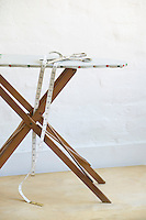 Scissors and measuring tape on ironing board