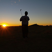 Dec 12th 2003.....Quyarra, Mosul, Iraq.....US Army Golf Course.....Lt-Col Jeff Kelley play his shot at first light on a 6 hole couse built at the base of the 101st Airbourne 50kms south of Mosul in Northern Iraq. It is by location perhaps the most hostile course in the world and reckoned to be Iraq's first and only golf course.s