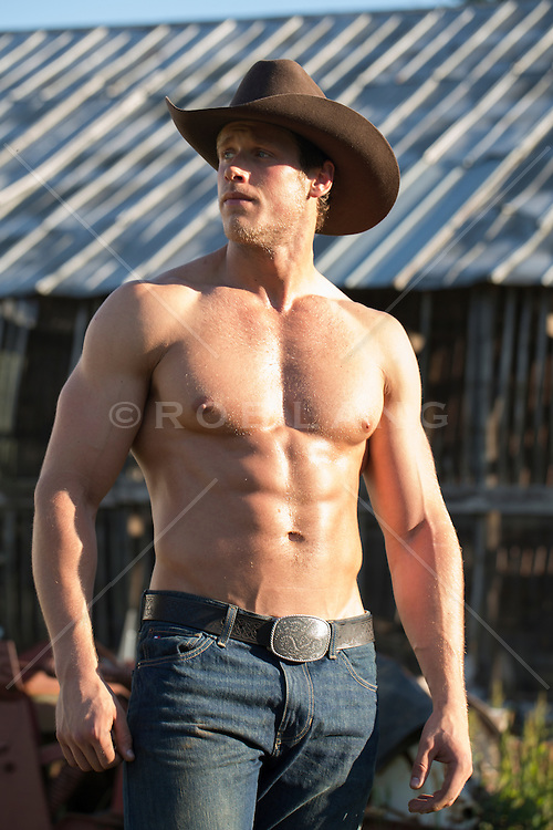 All American cowboy with a muscular body outdoors on a ranch