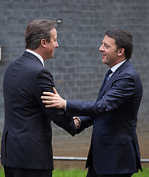 (L-R) David Cameron greets the Prime Minister of Italy Matteo Renzi at Downing Street. Matteo Renzi leader of the centre-left Democratic Party, is making his first visit to the UK.,10 Downing Street, London, United Kingdom. Tuesday, 1st April 2014. Picture by Daniel Leal-Olivas / i-Images