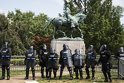 August 12, 2017 - Charlottesville, Virginia, United States - Riot Police formed a line of defense by General Lee's statue in Lee Park in Charlottesville. Alt-right group and white supremest members gathered and formed a big rally in Lee Park. (Credit Image: © Go Nakamura via ZUMA Wire)