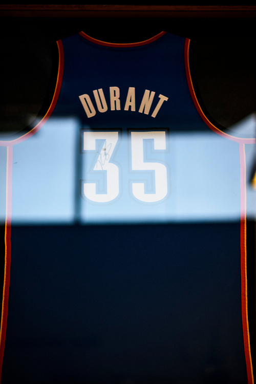 Capitol Heights, Maryland - March 29, 2017: A signed, framed Kevin Durant jersey hangs in the Kevin Durant Den in the Seat Pleasant Activity Center, March, 29, 2017. NBA super star Kevin Durant has donated a substantial amount of money to help renovate the Seat Pleasant Activity Center where he learned to play basketball. Durant's AAU coach and mentor Charles &quot;Chuckie&quot; Craig, who worked at the Activity Center, was gunned down in May 2005 at the age of 35. Durant wears #35 in Craig's honor.<br /> <br /> <br /> NBA Superstar Kevin Durant's jersey number &quot;35&quot; is a tribute to his rec. league coach and mentor Charles &quot;Chuckie&quot; Craig, who was gunned down in at a night club in Laurel, Md., in 2005 when he was 35 years old. <br /> <br /> CREDIT: Matt Roth for The New York Times<br /> Assignment ID: 30204524A