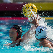 11 February 2018: The San Diego State  women's water polo team competes in day two of the Triton Invitation on the campus of UCSD. San Diego State Aztecs utility Emily Bennett (13) attempts a shot in the fourth quarter while being defended by CSUN Matadors Katelyn Fairchild (5). The Aztecs took on the #23 CSUN Matadors Sunday morning and came away with a 8-5 win.<br /> More game action at www.sdsuaztecphotos.com