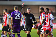 Red Card - Alex Whitmore (25) of Grimsby Town is sent off by referee Christopher Sarginson for a reckless tackle on Jake Taylor (25) of Exeter City during the EFL Sky Bet League 2 match between Exeter City and Grimsby Town FC at St James' Park, Exeter, England on 29 December 2018.