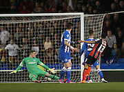 AFC Bournemouth striker Callum Wilson scores to make it 2-0 to Bournemouth during the Sky Bet Championship match between Brighton and Hove Albion and Bournemouth at the American Express Community Stadium, Brighton and Hove, England on 10 April 2015.