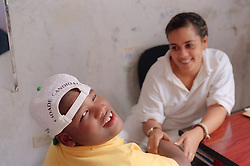 Child with cerebral palsy having speech therapy at the Centre for Rehabilitation and Education of Children with Disabilities in Havana; Cuba,