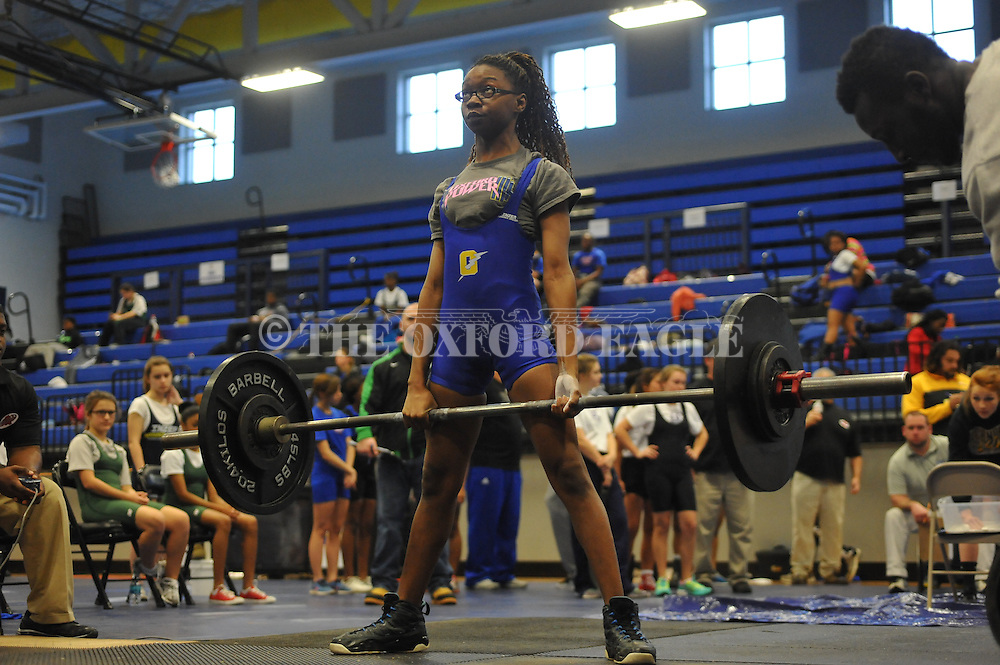 Oxford High's Patricia Rogers does the dead lift during the girls Class 3 Region 1 powerlifting meet at Oxford High School in Oxford, Miss. on Saturday, February 21, 2015.