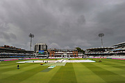 General view of Lords with the covers on the wicket as light rain and dark clouds roll in above the ground ahead of the final days play during the International Test Match 2019 match between England and Australia at Lord's Cricket Ground, St John's Wood, United Kingdom on 18 August 2019.