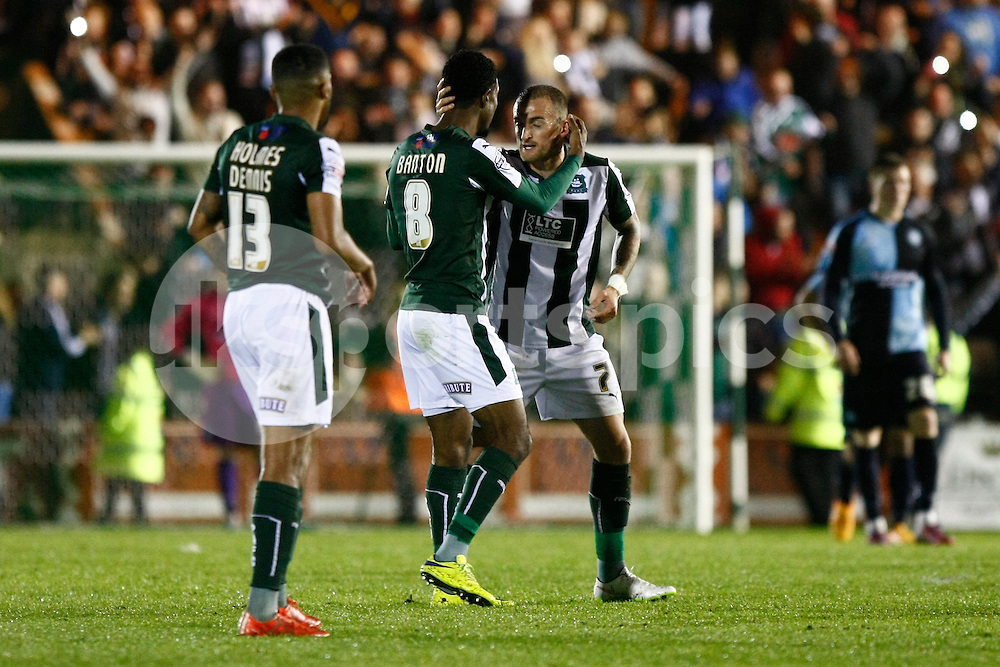 Jason Banton of Plymouth Argyle is congratulated by Lewis Alessandra of Plymouth Argyle after scoring his side's second goal during the Sky Bet League 2 Play Off 1st Leg match between Plymouth Argyle and Wycombe Wanderers at Home Park, Plymouth, England on 9 May 2015. Photo by Mark Hawkins.