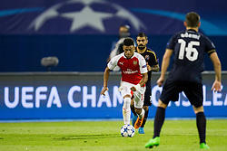 Alex Oxlade-Chamberlain #15 of Arsenal F.C. and Arijan Ademi #16 of GNK Dinamo Zagreb during football match between GNK Dinamo Zagreb, CRO and Arsenal FC, ENG in Group F of Group Stage of UEFA Champions League 2015/16, on September 16, 2015 in Stadium Maksimir, Zagreb, Croatia. Photo by Urban Urbanc / Sportida