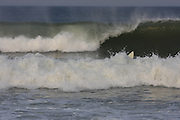 Surfer's Crash at the Marconi Beach, Cape Cod, Massachusetts,USA, September 3, 2011.
