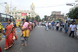 August 16, 2017 - Kolkata, West Bengal, India - Men and women workers some with their children of garment industry specially tailors rallied to Raj Bhavan or Governor House and submit a deputation to protest against recent implementation of Goods and Service Tax or GST over dress and garment industry in Kolkata. (Credit Image: © Saikat Paul/Pacific Press via ZUMA Wire)