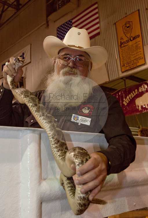 SWEETWATER, TX - MARCH 14: A Jaycees volunteer shows off a western diamondback rattlesnake brought in by hunters during the 51st Annual Sweetwater Texas Rattlesnake Round-Up, March 14, 2009 in Sweetwater, Texas. Approximately 24,000 pounds of rattlesnakes will be collected, milked for venom and the meat served to support charity. (Photo by Richard Ellis)