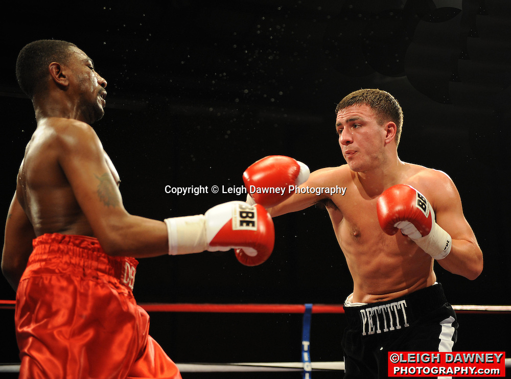 Lewis Pettitt (pro debut in black shorts) defeats Delroy Spencer at Gorsebrook Leisure Centre Dagenham on 14th May 2010. Frank Maloney Promotions. Photo credit: © Leigh Dawney