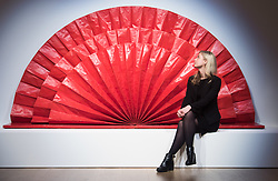 "Bonhams, Mayfair, London. A woman admires an Untitled ""red fan"" sculpture estmated at £1.5 - 2 million by Kazuo Shiraga to be auctioned at Bonhams post-war and Contemporary art sale. ///FOR LICENCING CONTACT: paul@pauldaveycreative.co.uk TEL:+44 (0) 7966 016 296 or +44 (0) 20 8969 6875. ©2015 Paul R Davey. All rights reserved."
