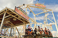 Brooklyn, New York, USA. 10th August 2013.  Riders are entering the finish of the Steeplechase ride at Luna Park amusement park during the 3rd Annual Coney Island History Day.