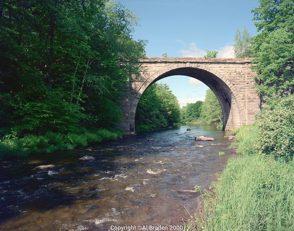 Historic stone arch railroad bridge south of Keene, New Hampshire, (ca 1849).