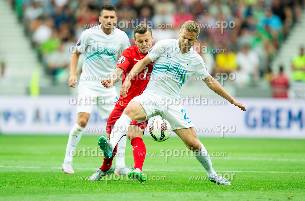 Jack Wilshere of England vs Ales Mertelj of Sloveniaduring the EURO 2016 Qualifier Group E match between Slovenia and England at SRC Stozice on June 14, 2015 in Ljubljana, Slovenia. Photo by Vid Ponikvar / Sportida