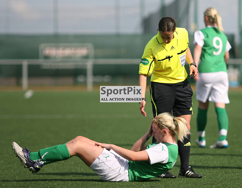 Hibernian's Siobhan Hunter goes down for the second time after a knock to the head...Glasgow City vs Hibernian Ladies - Scottish Women's Premier League 22nd April 2012...22-04-2012. (Photo by Jonathan Faulds)