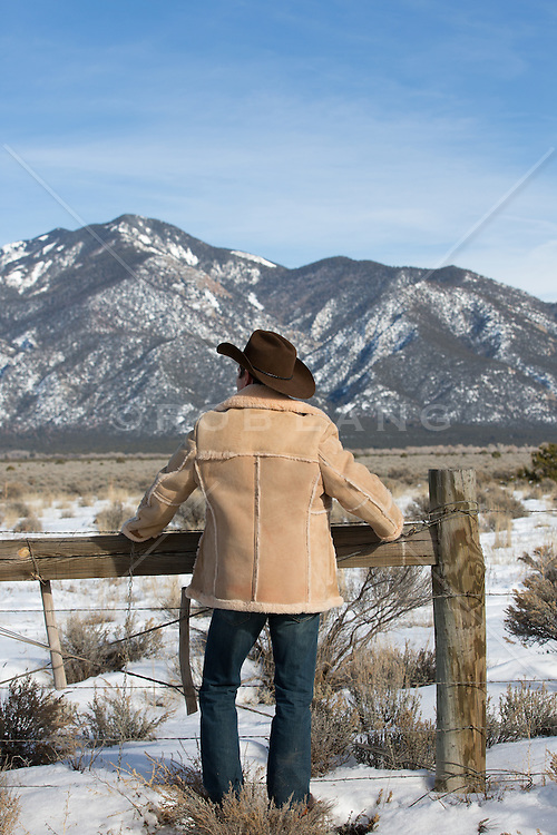 cowboy looking out over a mountain range