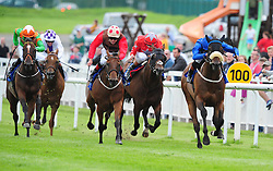 Toscanini ridden by James Doyle (right) before winning the Qatar Racing & Equestrian Club Phoenix Sprint Stakes ahead of Eastern Impact ridden by Pat Smullen at Curragh Racecourse, Co. Kildare, Ireland.