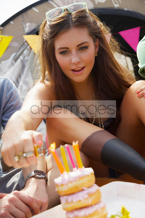 Teenage Girl Lighting Birthday Candles
