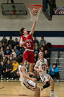 Laconia's Jakob Steele goes up for a shot against Plymouth's Nick Qualey and Dan Carey during NHIAA Division III basketball Tuesday evening.  (Karen Bobotas/for the Laconia Daily Sun)