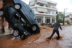 Nov. 15, 2017 - Mandra, Greece - A man walks through a waterlogged area. The strong torrential downpour has claimed 15 lives, according to the latest official count by the Health Ministry. (Credit Image: © Lefteris Partsalis/Xinhua via ZUMA Wire)