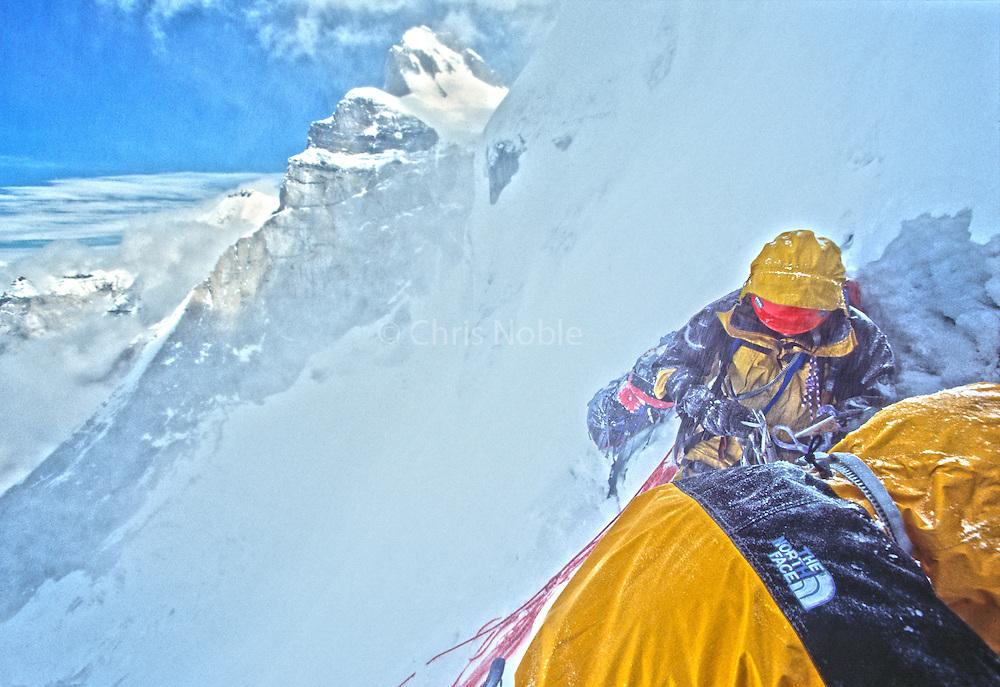 Kitty Calhoun and Jay Smith climbing in through spindrift avalanches on the North Face of Thelay Sagar, Garwal Himal, India